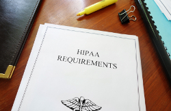 HIPAA Requirements healthcare privacy document on an office desk